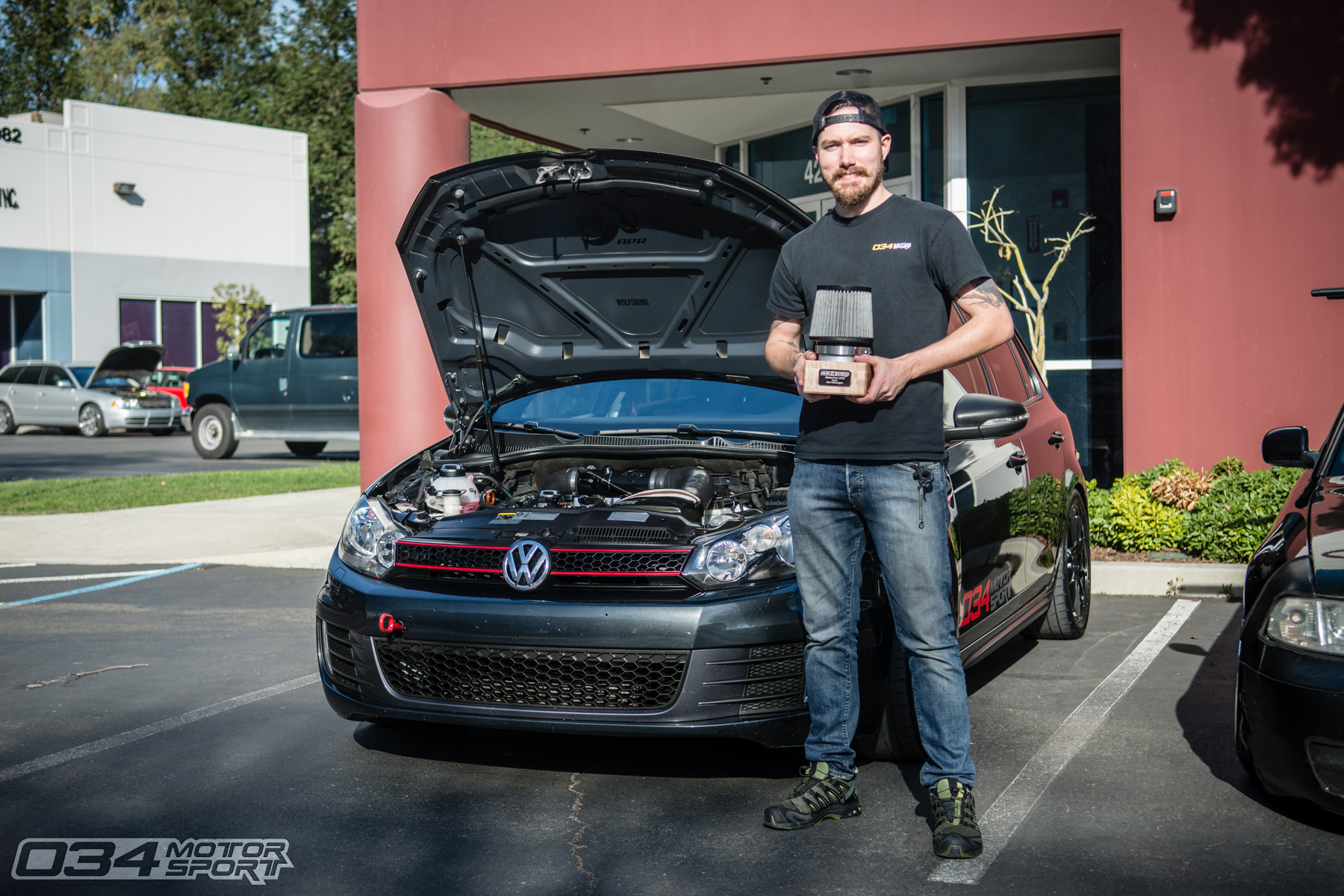 Josh and his MkVI 2013 Volkswagen GTI winning Best Volkswagen at WinterFest 2018